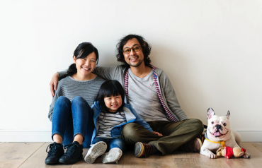 Happy Asian family in new home